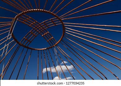 Red wood frame roof Shanyrak of Yurt against a blue sky at Saty Kazakhstan