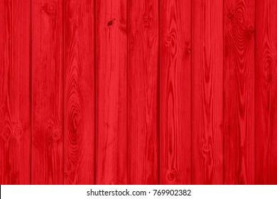Red wood plank texture of pine grain with knots. Cool wooden background.