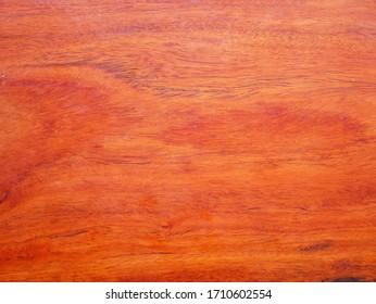 red wood texture background. teak wood panel. laminate plywood floor