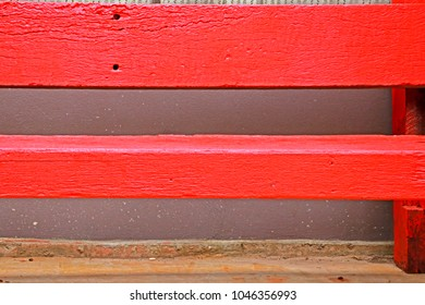 Red wooden bench