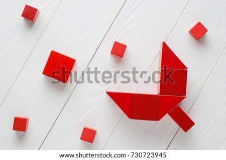Red wooden blocks on white wooden background, top view. Abstract merger and acquisition business concepts, join company.