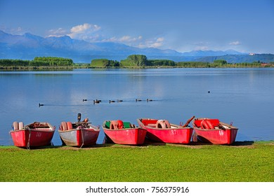 Red wooden boat on the Candia Lake in Piedmont