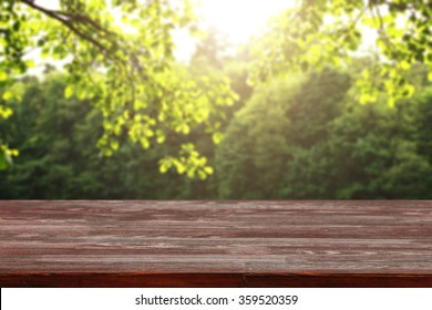 red wooden desk of spring time and sun light