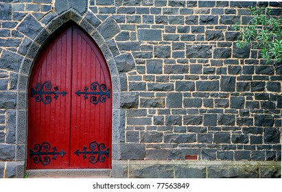 red wooden door in bluestone church