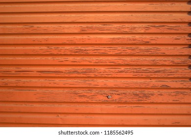 Red wooden door with flaked paint