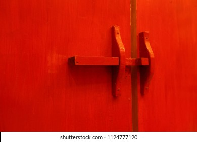 Red wooden door latch and lock in traditional Thai temple. with copy space