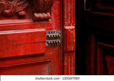 Red Wooden Door with Numeric Lock