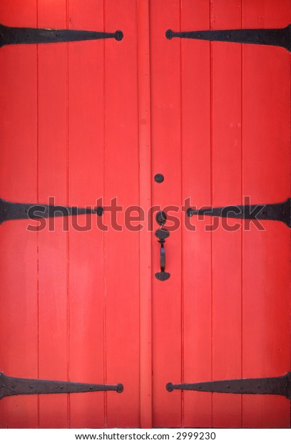 red wooden doors with black hardware