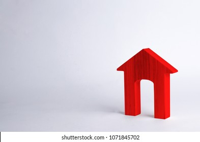 Red wooden house with a large doorway on a white background. The concept of buying and selling real estate, rental housing. Affordable housing, investment and construction. School