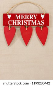 Red wooden Merry Christmas and heart retro sign on a neutral background with space for copy