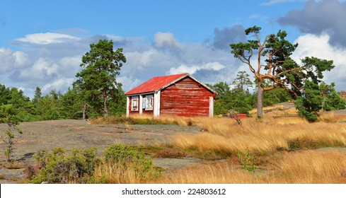 Red wooden old house on top of mountain