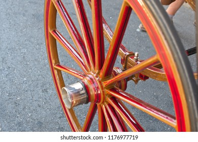 Red Wooden Spoke Wheel from a Horse-drawn Carriage.Close-up