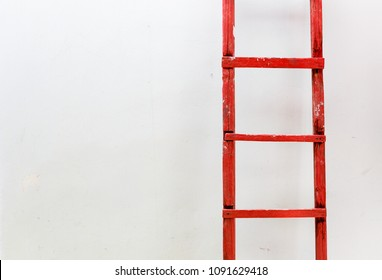 Red wooden staircase on a white background. Motivation business concept