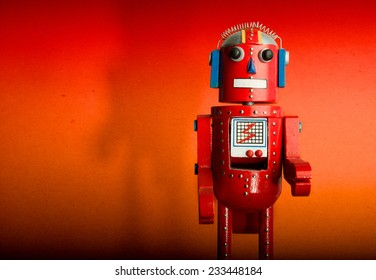 A Red Wooden Toy Robot