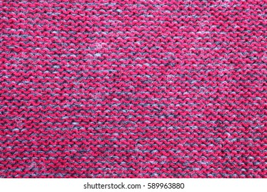 Red wool fabric texture macro. Background from a natural textile material.
