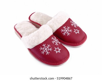Red wool house slippers isolated on white background