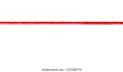Red woolen thread stretched on a white background