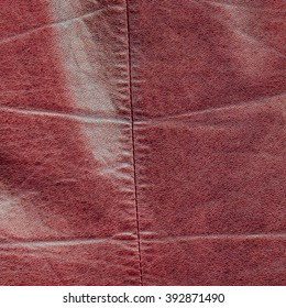 red  worn leather texture as background