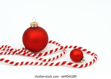 red xmas bauble and  ribbon on white