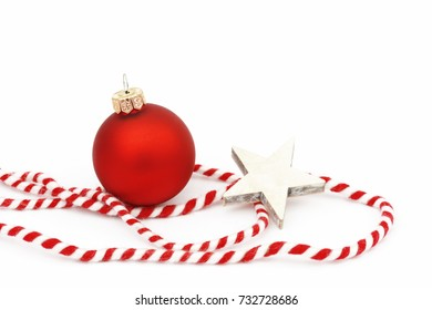 red xmas bauble and star with ribbon on white