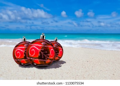 Red Xmas or christmas balls on paradise beach  - Shutterstock ID 1133075534
