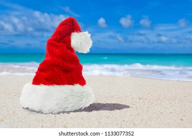 Red Xmas or christmas Santa Hat on paradise beach - Shutterstock ID 1133077352