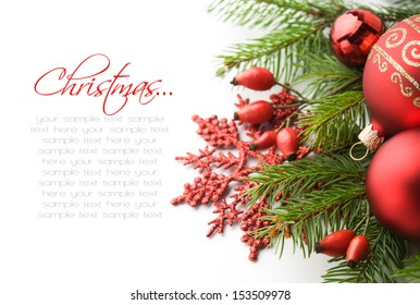 Red xmas decorations on white background with copy space