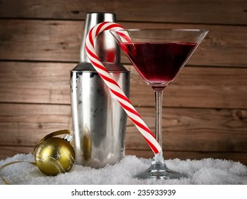 Red Xmas martini with frozen shaker on wooden background