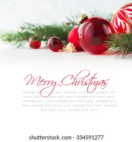 Red xmas ornaments on white background. Merry christmas card. Winter holiday theme. Happy New Year. Space for text.