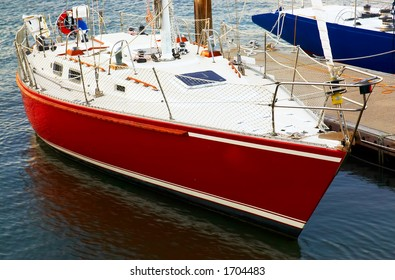 A red yacht in the harbor.