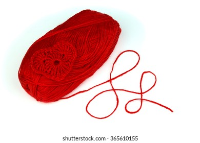 Red yarn with knitted heart.