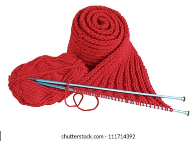 Red yarn and needles making scarf isolated on white