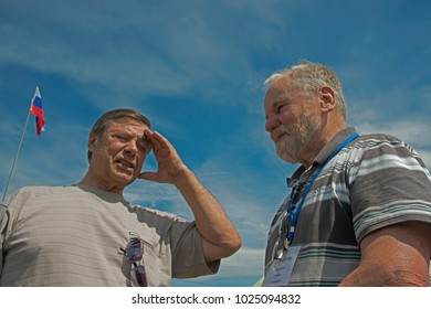 Red Yasyl, Perm Krai, Russia, - on July 8, 2017 / member of the union of artists of Russia Stepan Krivoshchekov and artist Vladimir Hlyupin, from  right to left - 5th  sculptors festival in Red Jasyl
