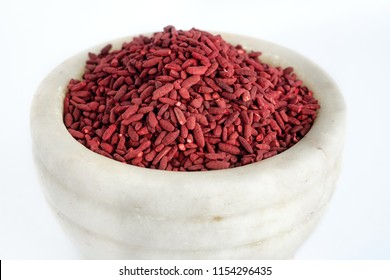 Red yeast fermented rice on mortar grinding bowl