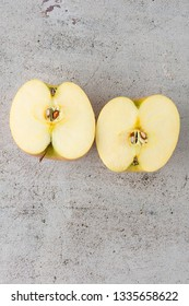 Red and yellow apples fruit on table concrete modern background. Cuts