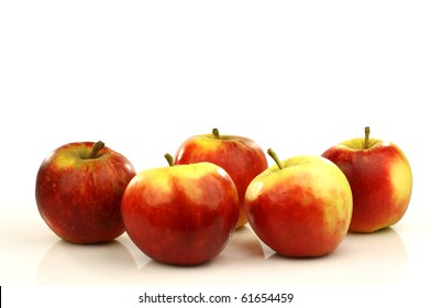 red and yellow apples on a white background