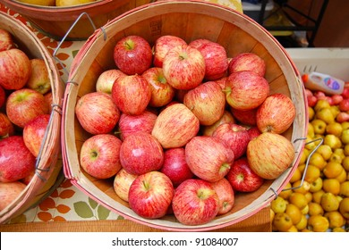 Red and Yellow Apples in Wooden Basket