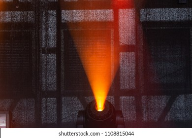 red and yellow beams of lamps on stage at popmusic festival in south germany city schwaebisch gmuend