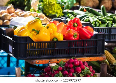 red and yellow bell peppers on a street market