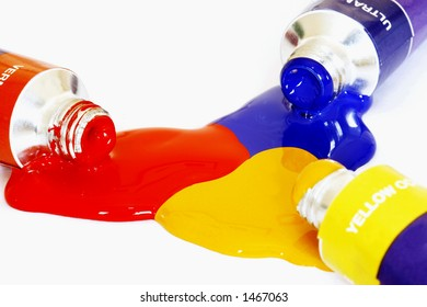 Red yellow and blue acrylic paints pouring from a tube. Colour can be easily changed to any colour using hue/saturation in photo package