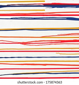 Red, yellow, blue, flowing on a white wooden floor.