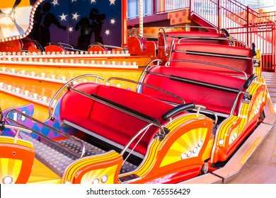 Red and yellow carnival festival carriage amusement ride