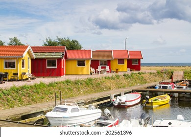 Red and yellow coastal wooden houses on Bornholm, Denmark