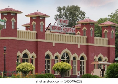 Red yellow coloured Howrah Station Model with nature public park around.