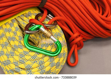 Red and yellow dynamic ropes and attached carabiner