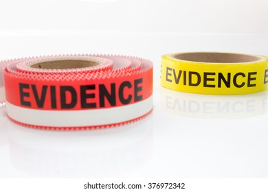 red and yellow evidence tape on white background focus on back object