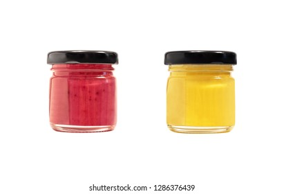 Red and yellow fruit honey or jam in glass transparent jars isolated on white background