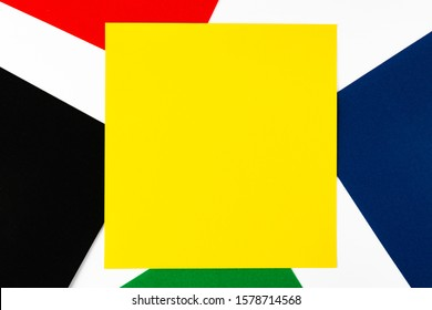 Red, yellow, green, black and blue sheets of colored velvet paper. Bright color background. Horizontal orientation. Square and diagonal lines strip. Top view flat lay with copy space.