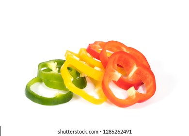 Red, yellow, green fresh and healthy sliced peppers on a white background