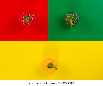 red, yellow and green peppers on a colored background